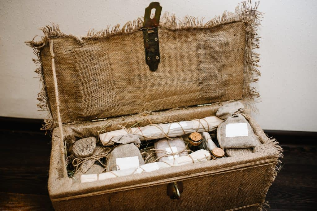 Sack-covered wooden gift box filled with small gifts